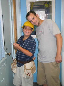 Boy in Hard Hat and Teacher